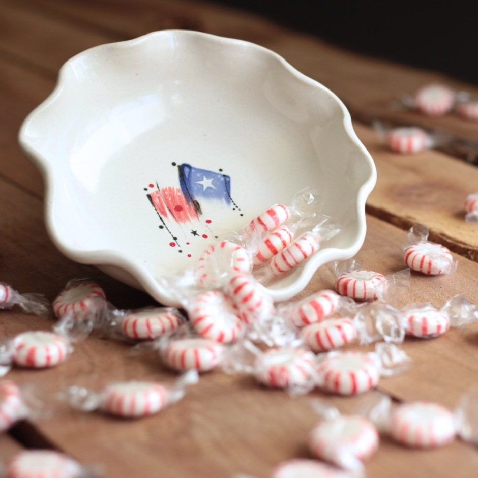 a candy dish spilling its goodies